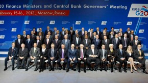 Finance ministers and central bank governors pose for a family photo during a meeting of G20 finance ministers and central bank governors in Moscow
