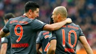 Na, wie haben wie das gemacht? Lewandowski (links) und Robben treffen.