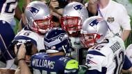 Ganz nah am Superstar: Sebastian Vollmer (l.) jubelt mit Quarterback Tom Brady (r.)
