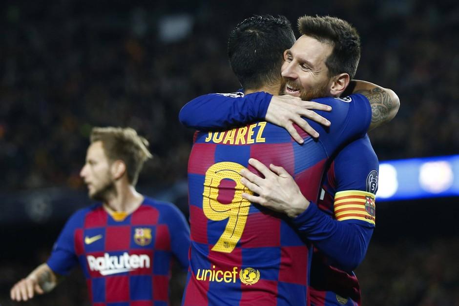 Torschützen unter sich: Barcelonas Lionel Messi (rechts) und Luis Suarez (Mitte) beim Spiel gegen Dortmund