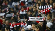 Fans of Eintracht Frankfurt react before their German first division Bundesliga soccer match against Bayern Munich in Frankfurt