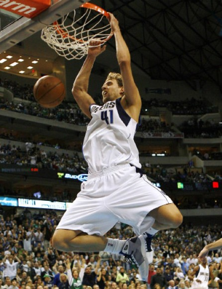 Nowitzki dunks the ball in the second half of their NBA basketball game in Dallas