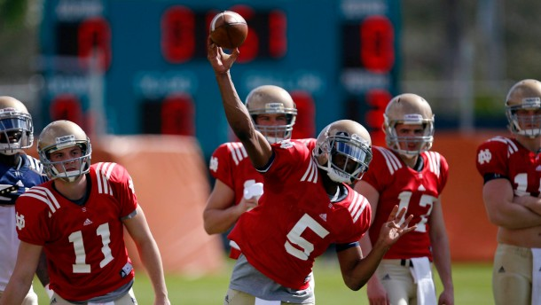 Fighting Irish quarterback Golson throws a pass during practice for the NCAA college football 2013 Discover BCS National Championship game in Davie, Florida