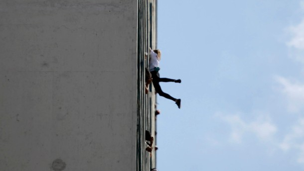 "Alain Robert of France, who is known as ""Spiderman"", climbs the Habana Libre hotel in Havana"