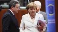 Mario Draghi und Angela Merkel während des EU-Gipfeltreffens im Juni 2012 in Brüssel.
