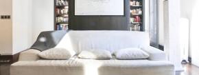 In Perfektion erstarrt: durchkomponierte Wohnlandschaft in Grau-Weiß.