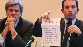 France's Social and Solidarity Economy junior minister Hamon shows a meat packing sheet during a joint news conference with Agriculture Food Processing Industry and Forests Minister Le Foll in Paris