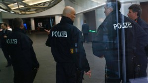 Police officers stand inside lobby of headquarters of Deutsche Bank AG  in Frankfurt