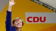 Merkel in Siegerpose: Ein ziemlich wahrscheinliches Bild.