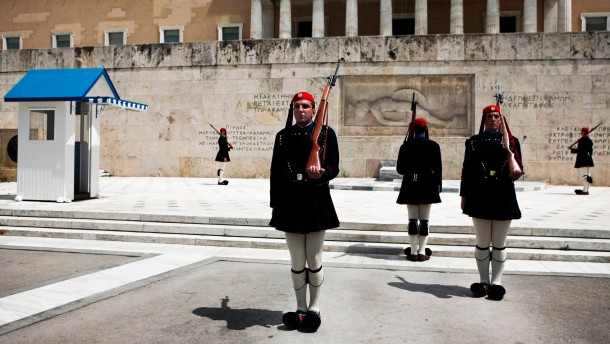 Greek Presidential Guards perform a change of shift at the Tomb of the Unknown Soldier in Athens