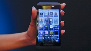 A BlackBerry salesperson displays a BlackBerry Z10 during the launch of the BlackBerry 10 smartphone in Mumbai