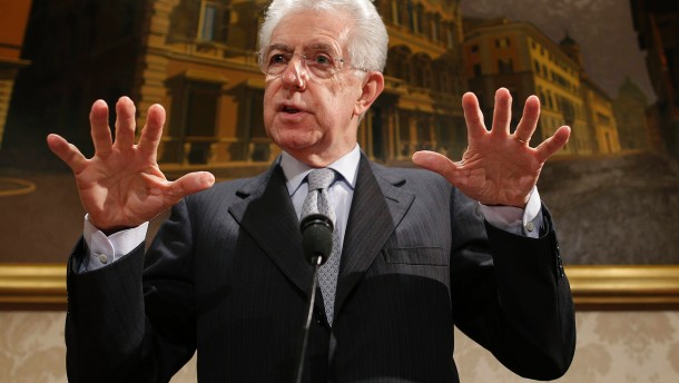 Italy's outgoing Prime Minister Mario Monti speaks during a news conference in Rome