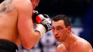 Ukrainian WBA, WBO, IBO and IBF heavy weight boxing world champion Vladimir Klitschko watches his Polish challenger Mariusz Wach during their fight  in Hamburg