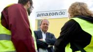 Verdi-Chef Frank Bsirske und Amazon streiten schon seit Jahren.