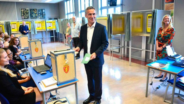Norwegian Prime Minister Jens Stoltenberg casts his ballot for the parliamentary election at a polling station in Oslo