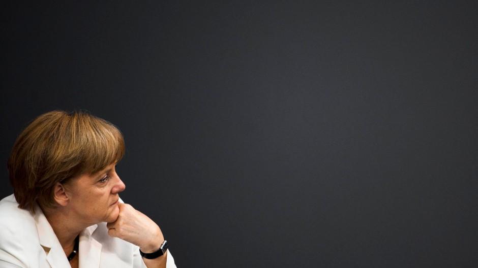 Kaschiert die abermalige Niederlage: Angela Merkel