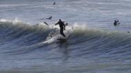 Wellenreiten geht an Neuseelands Küsten prima.