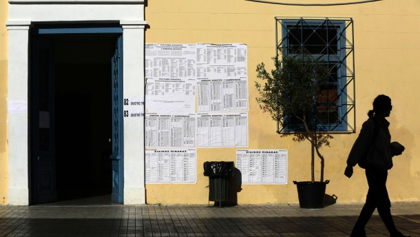 A woman leaves a polling station in Athens after voting in Greece's national election