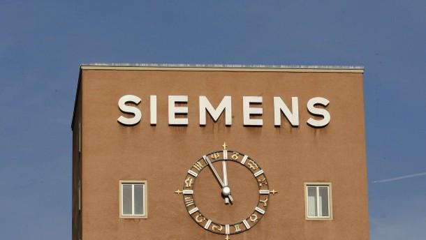 Merkel hofft auf ruhigere Zeiten bei Siemens