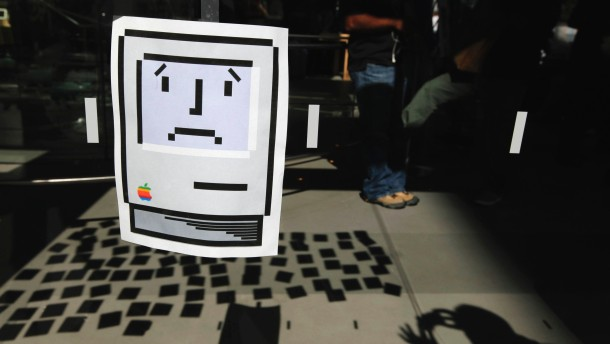 File photo of a sad Macintosh icon printout  is seen on the exterior of an Apple store in New York