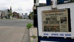 A Times-Picayune newspaper box sits on a deserted downtown street prior to the arrival of Hurricane Gustav in New Orleans