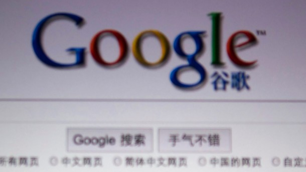 File illustrative photograph of a person posing with a magnifying glass in front of a Google search page in Shanghai