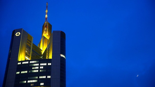 The moon rises next to the head quarters of Germany's Commerzbank in Frankfurt