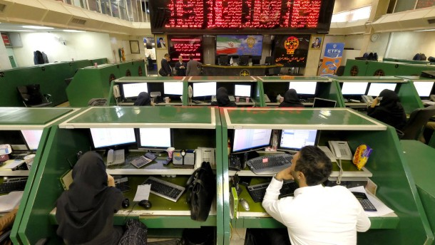 Stock market employees work at Tehran's Stock Exchange