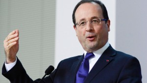 France's President Francois Hollande holds a news conference at the end of a European Union leaders summit in Brussels