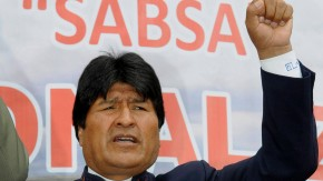 Bolivian President Evo Morales sings the national anthem during a ceremony at the Jorge Wilstermann airport in Cochabamba, which is affected by the nationalization of Sabsa