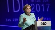 Merkel warnt vor Steuerwettlauf nach unten