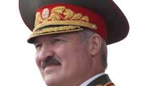 Belarussian President Alexander Lukashenko watches a military parade during celebrations marking Independence Day in Minsk