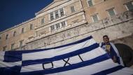 """Mit """"Nein"""" beim Referendum zu stimmen, fordert dieser Mann in Athen."""