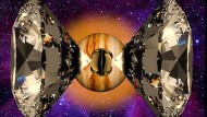 Wasserstoffprobe zwischen zwei Diamantspitzen einer Hochdruck-Stempelzelle, künstlerische Darstellung. Im Hintergrund ist der Jupiter eingeblendet. Im Inneren des Gasplaneten, soll Wasserstoff flüssig sein.