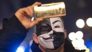 """Auf dem """"Maskenmarsch"""" in London."""