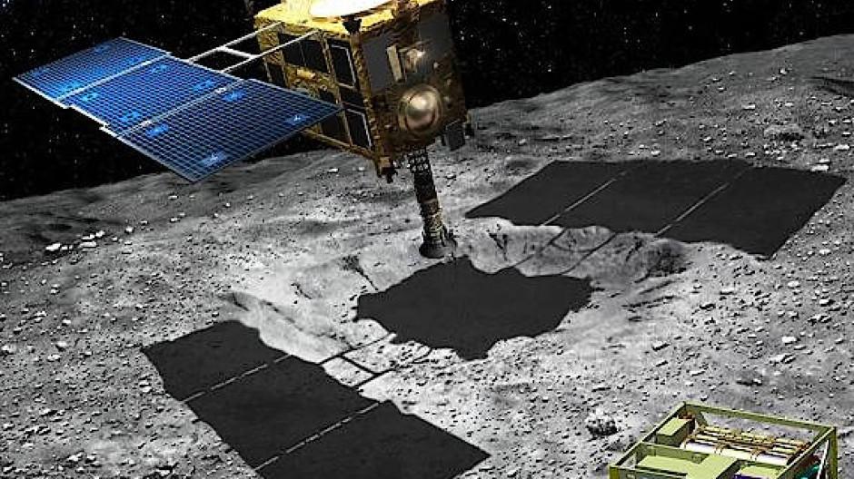 Künstlerische Darstellung der Hayabusa-Sonde beim Schürfen und Mascot (rechts) auf der Asteroidenoberfläche