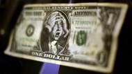 Da erschrickt sogar das Abbild George Washingtons: Die Krise hat viel Geld vernichtet - doch wo ist es geblieben?