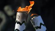 Krawalle behindern olympischen Fackellauf
