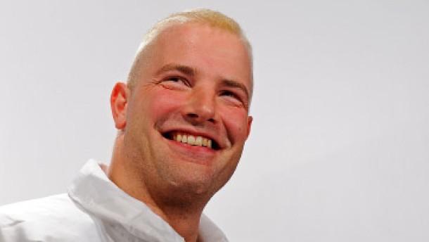 André Lange trägt die deutsche Fahne