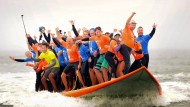 66 Surfer auf einem Brett
