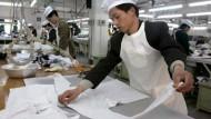 Gefährlicher als billige Arbeitskräfte sind Chinas finanzstarke Unternehmen