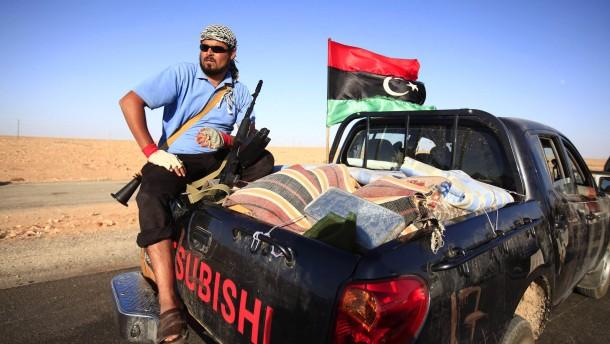 Interpol schreibt Gaddafi zur Fahndung aus