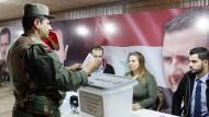 Umstrittene Parlamentswahlen in Syrien haben begonnen