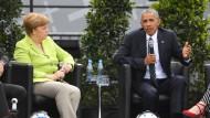 Obama und Merkel beschwören Glauben an eine bessere Welt