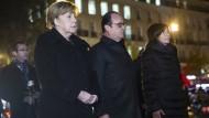 Merkel und Hollande gedenken Pariser Terroropfer