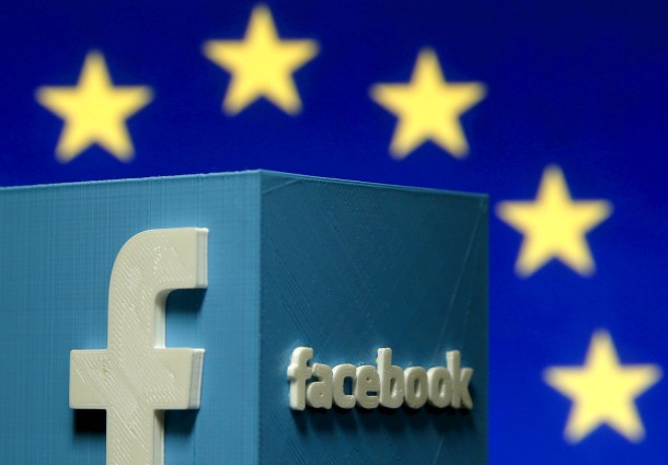 File picture illustration of a 3D-printed Facebook logo in front of the EU logo
