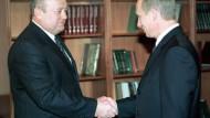 Präsident Putin und Premier Fradkow (2002)