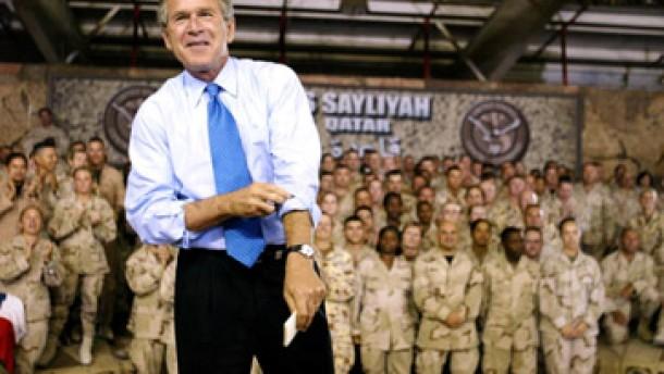 Bush krempelt die arme hoch