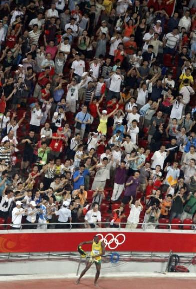 Usain Bolt of Jamaica celebrates winning men''s 100m final at the Beijing 2008 Olympic Games
