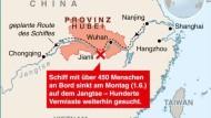 Angehörige drängen zur Unglücksstelle am Jangtse